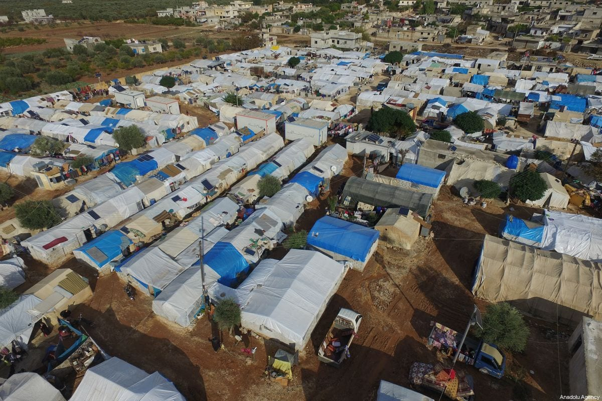 A drone photo shows an aerial view of the Kefernahum refugee camp, where Syrian refugees live, at the beginning of the winter season in northeastern Idlib, Syria on November 02, 2019 [Izzeddin Idilbi - Anadolu Agency]