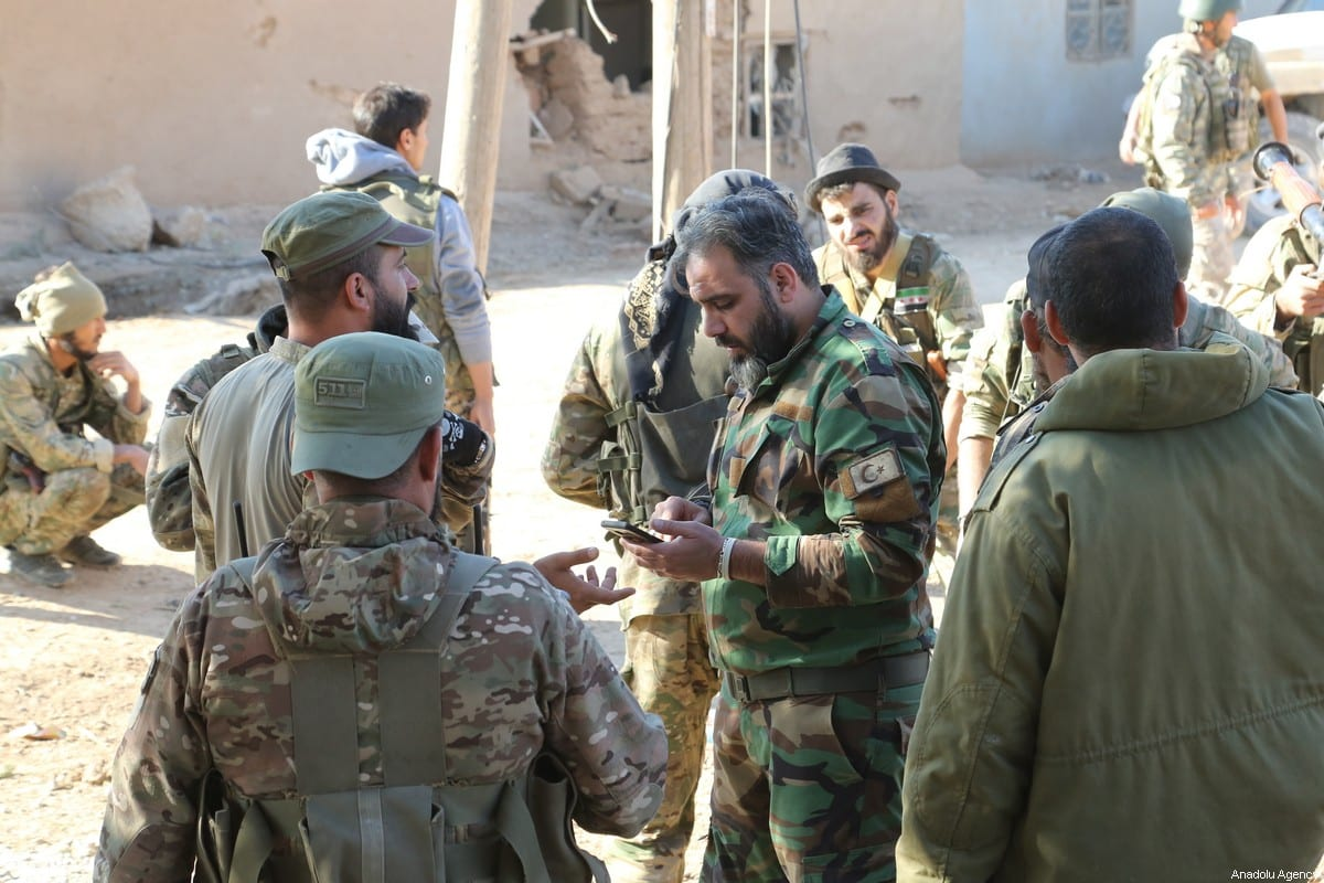 Syrian National Army (SNA) members seen after the area was cleared of other militia by Turkey's Operation Peace Spring, in eastern Ras Al-Ayn, Syria on 11 November, 2019 [Muhammed Nur/Anadolu Agency]