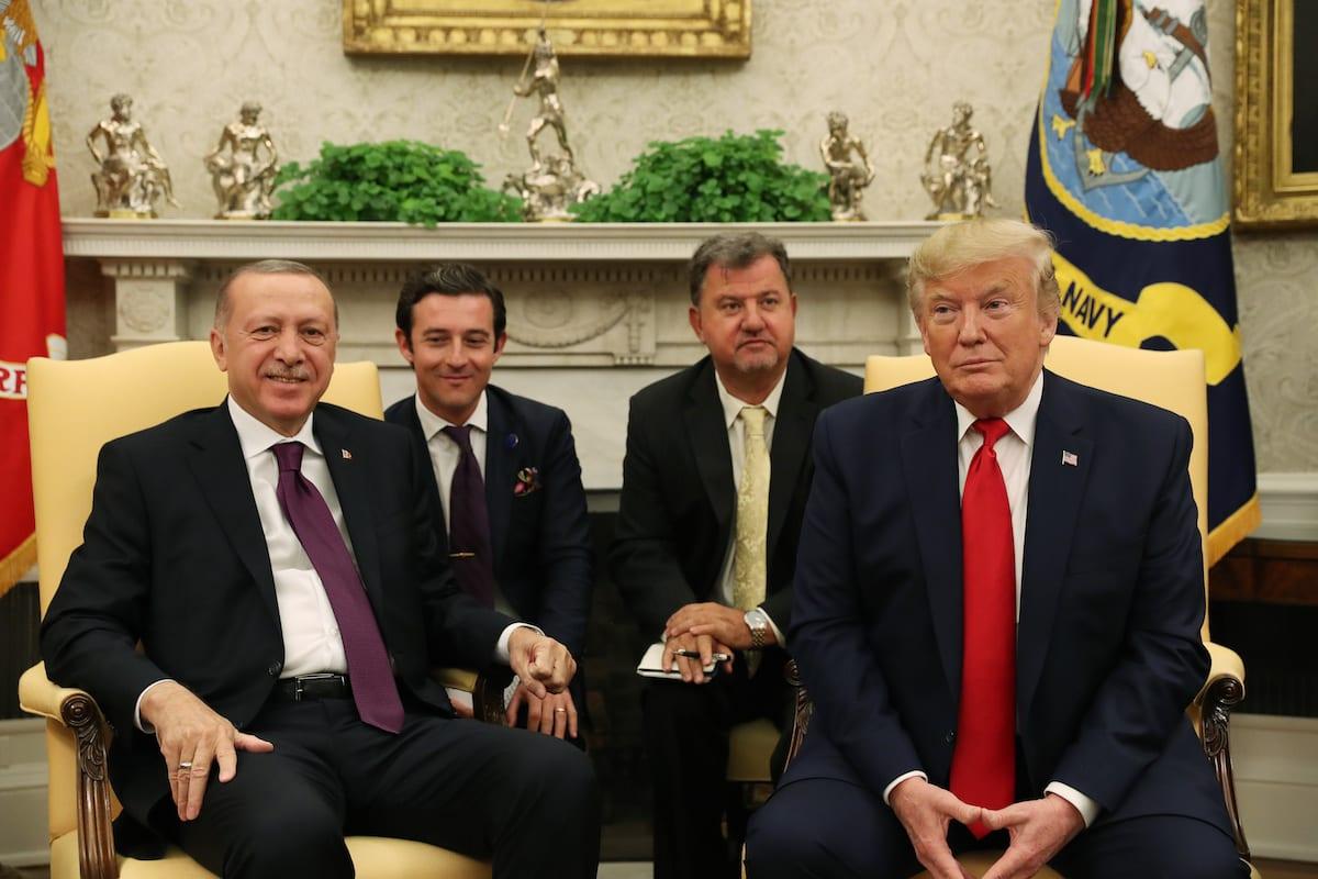 President of Turkey, Recep Tayyip Erdogan (L) and US President Donald Trump (R) meet with US senators in the Oval Office at the White House in Washington, United States on 13 November 2019. [Turkish Presidency / Murat Cetinmuhurdar / Handout - Anadolu Agency]