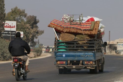 Syrian civilians with their belongings on their way to  Syrian-Turkey border as they leave the de-escalation zones due to attacks by the Assad regime and Russia, in Idlib, Syria on 15 November, 2019 [Muhammed Abdullah/Anadolu Agency]