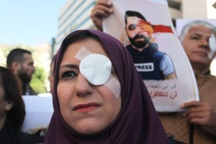 Palestinians, wearing left eye patch gather to stage a demonstration to protest against Israeli oppressions and violations towards journalists, in Nablus, West Bank on 17 November, 2019 [Nedal Eshtayah/Anadolu Agency]
