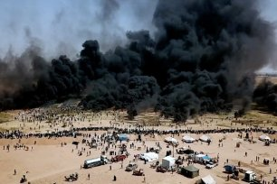 A still from the film 'Gaza' showing thick smoke rising from the air strike carried our by Israeli forces