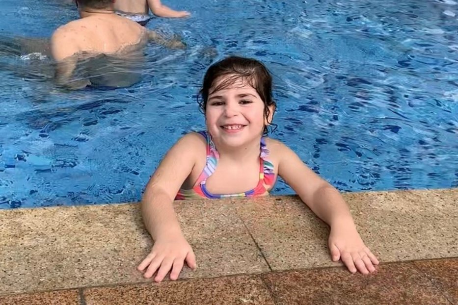 Dina Zeidan at a swimming pool