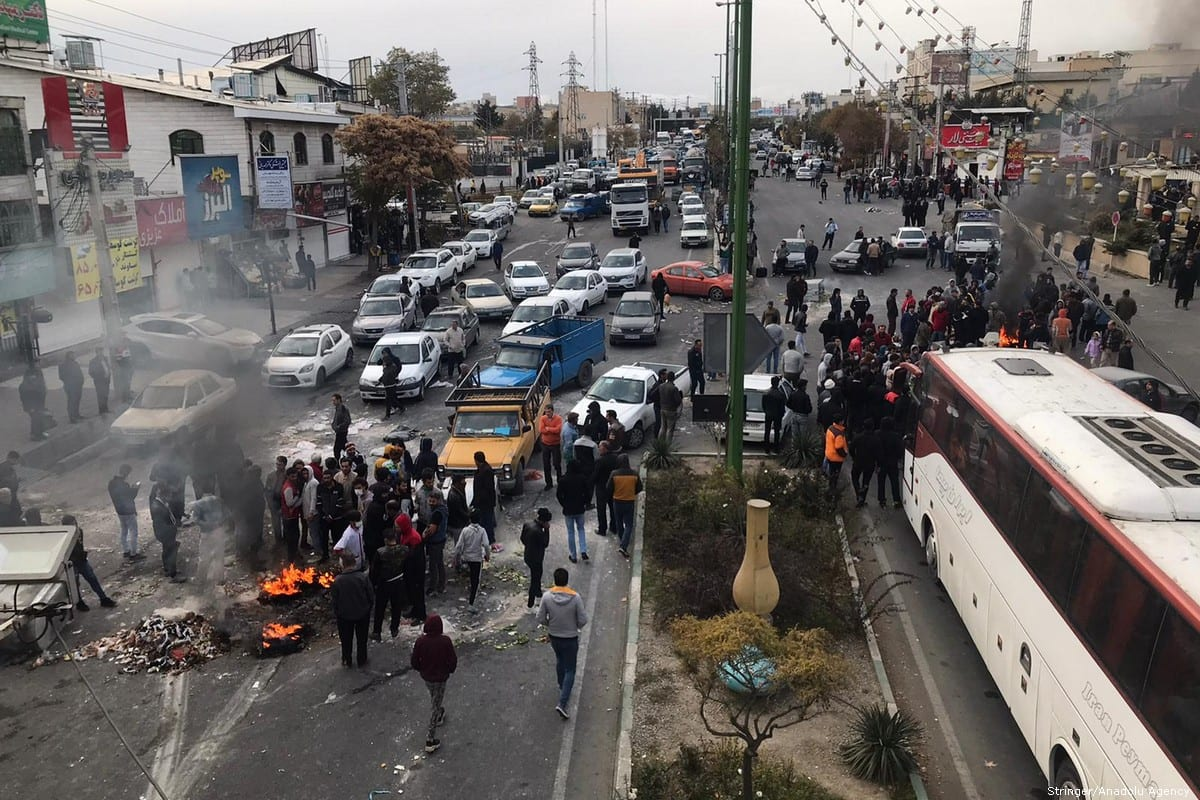 Protesters block the roads during a protest against gasoline price hike in Tehran, Iran on 16 November 2019 [Stringer/Anadolu Agency]