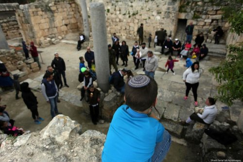Israeli settlers are seen at an ancient historical site as they celebrate the Jewish holiday of Passover, in the West Bank city of Nablus on 22 April 2019 [Shadi Jarar'ah/Apaimages]