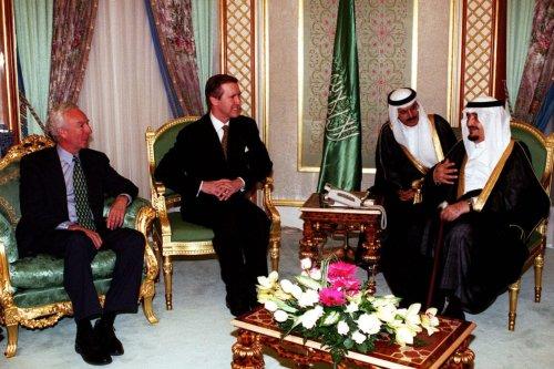 Former Saudi King Fahd bin Abd al-Aziz Al Saud (right) receives a visit by Secretary of Defense William S. Cohen (center) at his palace in Jeddah, Kingdom of Saudi Arabia on 8 February 1998. [Defense Gov - Helene C. Stikkel]