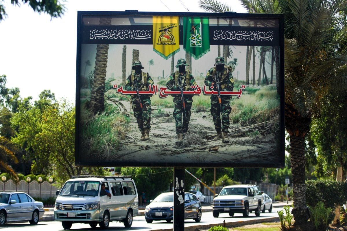 A propaganda billboard for the pro-Iran Hezbollah Brigades militia hanging over Palestine Street in the centre of the Iraqi capital Baghdad, on 20 June 2019 [AHMAD AL-RUBAYE/AFP/Getty Images]