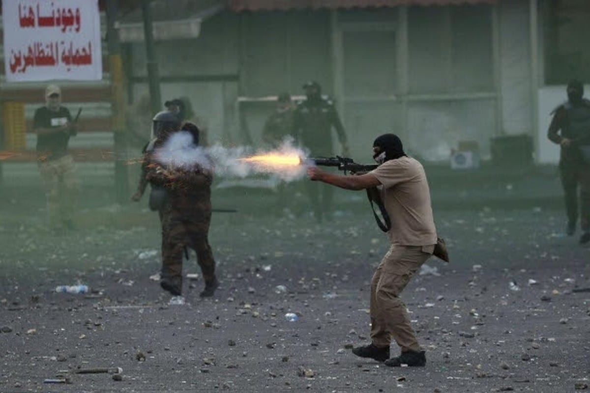 Iraqi forces firing tear gas at demonstrators in Baghdad on 11 November 2019 (AP)