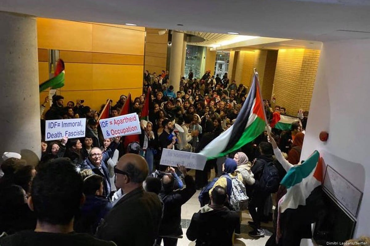 Pro-Palestinian students protest against an event which hosted Israeli army reservists at York University in Toronto, Canada on 20 November 2019 [Dimitri Lascaris/Twitter]