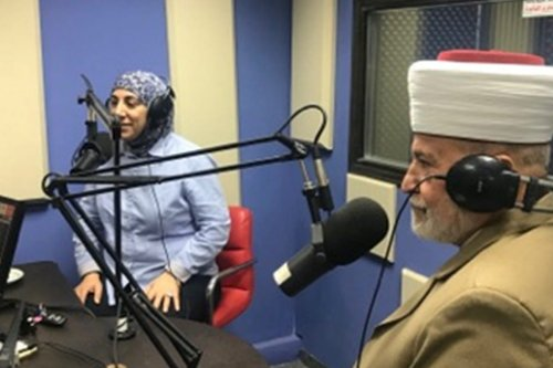 Dr Samah Jabr (L) discussing suicidewithin the context of Islam with a sheikh