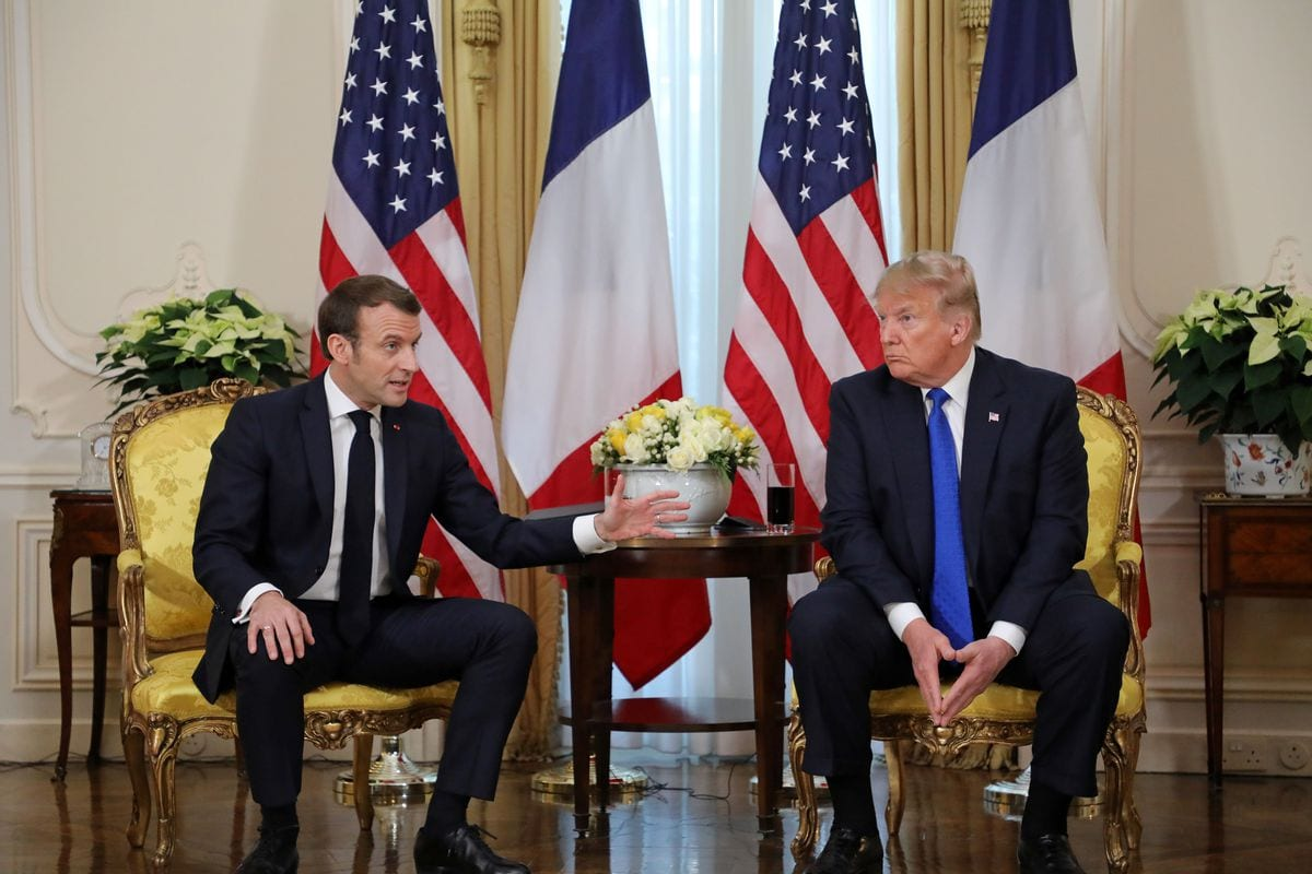 French president Emmanuel Macron (L) and US president Donald Trump (R) at the NATO summit in the UK in December, 2019 [Anadolu Agency]