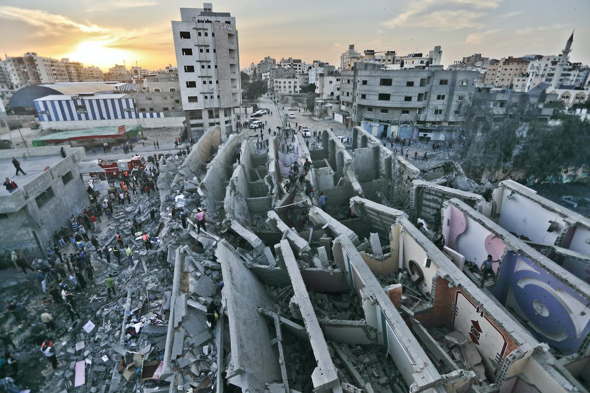 Damaged buildings are seen after Israel carried out air strikes in Gaza on 5 May 2019 [Mohammad Asad/Middle East Monitor]