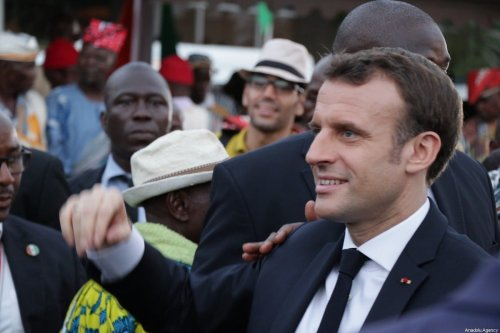 French President Emmanuel Macron seen during an official welcoming ceremony at the Felix Houphouet Boigny International Airport in Abidjan, Ivory Coast on December 20, 2019 [Cyrille Bah / Anadolu Agency]