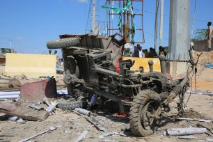 Damaged vehicles at the site after a bomb attack carried out to a checkpoint in Somalia's capital Mogadishu on December 28, 2019 [Sadak Mohamed / Anadolu Agency]