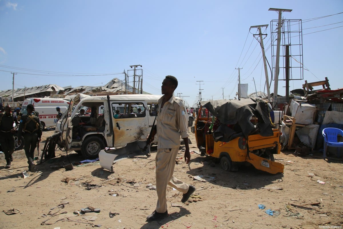 Damaged vehicles are seen at the site after a bomb attack carried out to a checkpoint in Somalia's capital Mogadishu on 28 December, 2019 [Sadak Mohamed/Anadolu Agency]