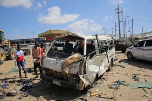 Damaged vehicles are seen at the site after a bomb attack in Somalia's capital Mogadishu on 28 December, 2019 [Sadak Mohamed / Anadolu Agency]