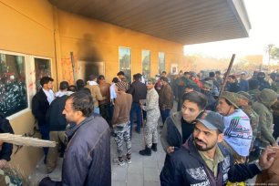 Outraged Iraqi protesters try to storm the US Embassy in Baghdad, protesting Washington's attacks on armed battalions belong to Iranian-backed Hashd Al-Shaabi forces on 31 December 2019 [Murtadha Sudani/Anadolu Agency]