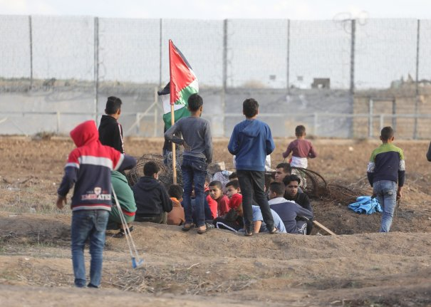 Palestinians gather at the separation fence for the Great March of Return on Friday 6 December 2019 [Mohammed Asad/Middle East Monitor}