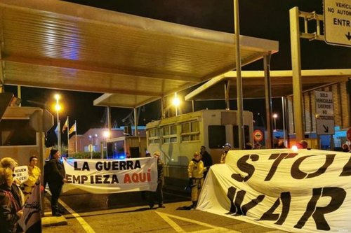 Anti-war campaigners protest at a Spanish port against the arrival of a Saudi cargo ship believed to be carrying US and Canadian manufactured arms to Yemen on 10 December 2019