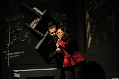 """Iraqi Kurdish actors perform in """"My ears are talking"""", a play directed by Kurdish Karukh Ibrahim denouncing the threat of the Islamic State (IS) to the Yazidi religious minority's women and girls, on 10 December, 2018, in Arbil, the capital of the autonomous Kurdish region of northern Iraq [SAFIN HAMED/AFP via Getty Images]"""