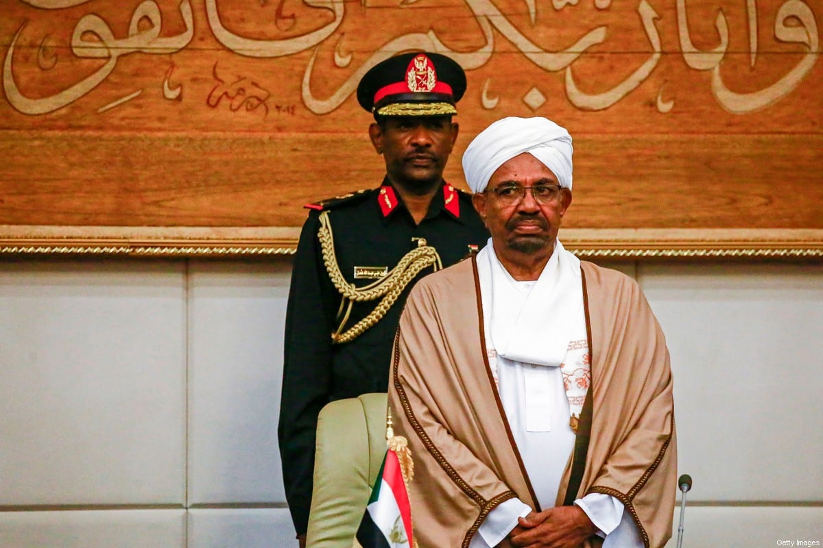 Sudan's Former President Omar al-Bashir attends a meeting with his new 20-member cabinet as they take oath at the presidential palace in the capital on 14 March 2019. [ASHRAF SHAZLY/AFP via Getty Images]