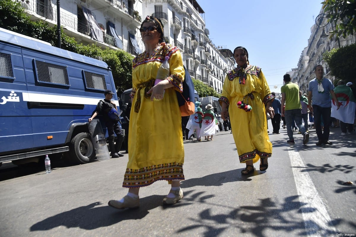 Algerian women wearing traditional Amazigh (Berber) dress walk to a demonstration in the capital Algiers during the weekly Friday protests against the government on June 28, 2019 [RYAD KRAMDI/AFP via Getty Images]