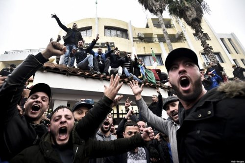 Algerian demonstrators chant slogans in front of the daira (sub-prefecture) of Tizi-Ouzou, in the Kabylie heartland of the Amazigh community, about 100 kms (62 miles) east of the capital Algiers, on 8 December, 2019 [RYAD KRAMDI/AFP via Getty Images]