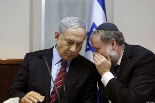 Israeli Prime Minister Benjamin Netanyahu listens to the Attorney General Avichai Mendelblit during the weekly cabinet meeting at his Jerusalem office on 16 November 2014. [GALI TIBBON/AFP via Getty Images]