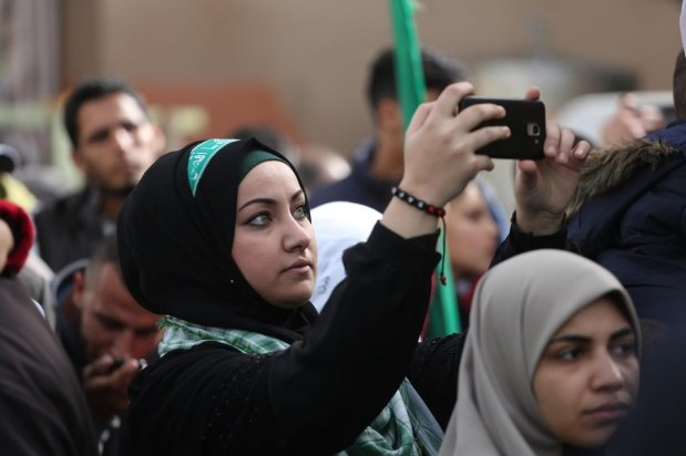 Palestinians come together to celebrate the 32nd anniversary of Hams in Gaza on 16 December 2019 [Mohammed Asad/Middle East Monitor]