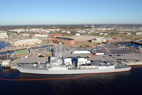 An aerial view of the Navy's newest guided-missile destroyer Pre-Commissioning Unit (PCU) Forrest Sherman (DDG 98) moored at Naval Air Station (NAS) Pensacola, on 28 January 2006 at NAS Pensacola. [US Navy - Patrick Nichols]