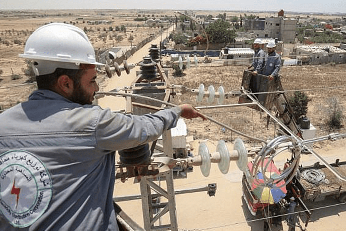 Palestinian electrical workers inspect power installations [Getty]