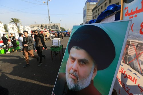 Poster of Sadrist Movement Leader Muqtada al-Sadr is seen as Iraqi demonstrators gather at Tahrir Square to carry out an anti-government protest ahead of Friday prayer in Baghdad, Iraq on 3 January 2020. [Murtadha Sudani - Anadolu Agency]