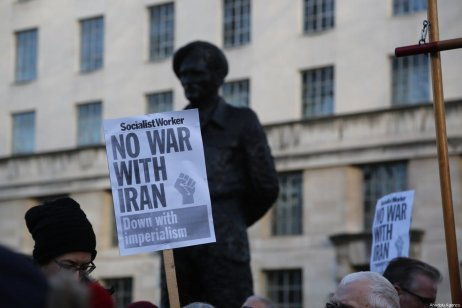 """People hold banners reading """"No War With Iran - Down With Imperialism"""" during an anti-war rally following the killing of Iranian Revolutionary Guards' Quds Force commander Qasem Soleimani by a US airstrike in the Iraqi capital Baghdad, on January 04, 2020 at Downing Street in London, United Kingdom [İlyas Tayfun Salcı / Anadolu Agency]"""