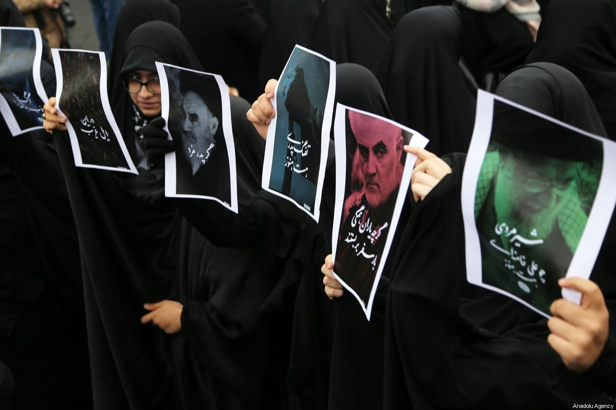 An Iranian woman carries an image of Iranian Revolutionary Guards' Quds Force commander Qasem Soleimani, who was killed in a US airstrike in the Iraqi capital Baghdad, on 4 January 2020 [Fatemeh Bahrami / Anadolu Agency]