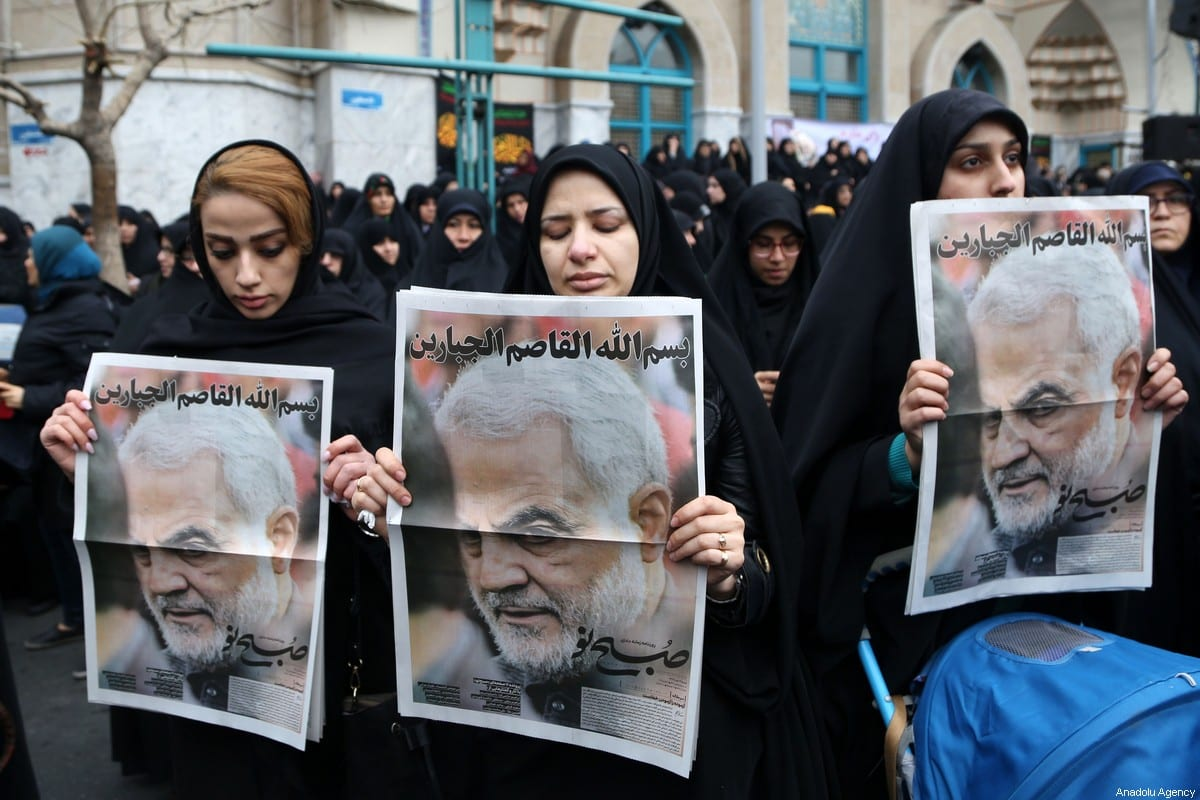 Iranian women carry images of Iranian Revolutionary Guards' Quds Force commander Qasem Soleimani, who was killed by a US airstrike in the Iraqi capital Baghdad, during an anti-US rally to protest the killing at Palestine Square in the capital Tehran, Iran on 4 January 2020. [Fatemeh Bahrami - Anadolu Agency]