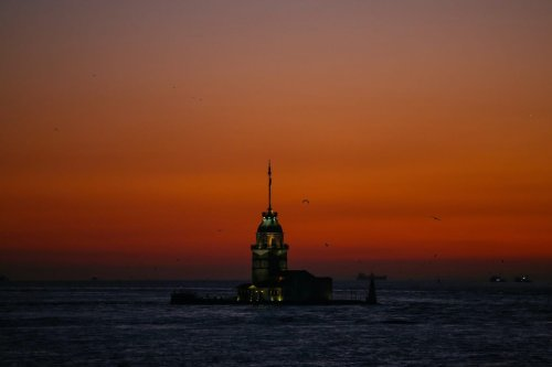 Maiden's Tower is seen under a red sky during sunset in Istanbul, Turkey on 10 January 2020. [Emrah Yorulmaz - Anadolu Agency]