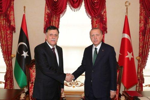President of Turkey Recep Tayyip Erdogan (R) meets Fayez al-Sarraj (L), Chairman of the Presidential Council of Libya's Government of National Accord (GNA), in Istanbul, Turkey on 12 January 2020. [Mustafa Kamacı - Anadolu Agency]