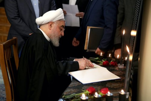 Iranian President Hassan Rouhani signs the memory book for the victims of Ukrainian 737 plane, which Iran announced to unintentionally shot down in Tehran, during a memorial for the victims at the presidential building in Tehran, Iran 25 on January 2020. [ranian Presidency / Handout - Anadolu Agency ]