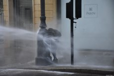 Security forces use water cannon on a protester as they clash in a protest against the country's economic and political situation in Beirut, Lebanon on January 18, 2020 [Mahmut Geldi / Anadolu Agency]