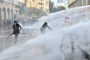 Security forces use water cannons during a protest against the country's economic and political situation in Beirut, Lebanon on January 18, 2020 [Hussam Chbaro / Anadolu Agency]