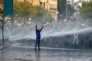 Security forces use water cannon on a protesters as they clash with protestors against the country's economic and political situation in Beirut, Lebanon on January 18, 2020 [Hussam Chbaro / Anadolu Agency]