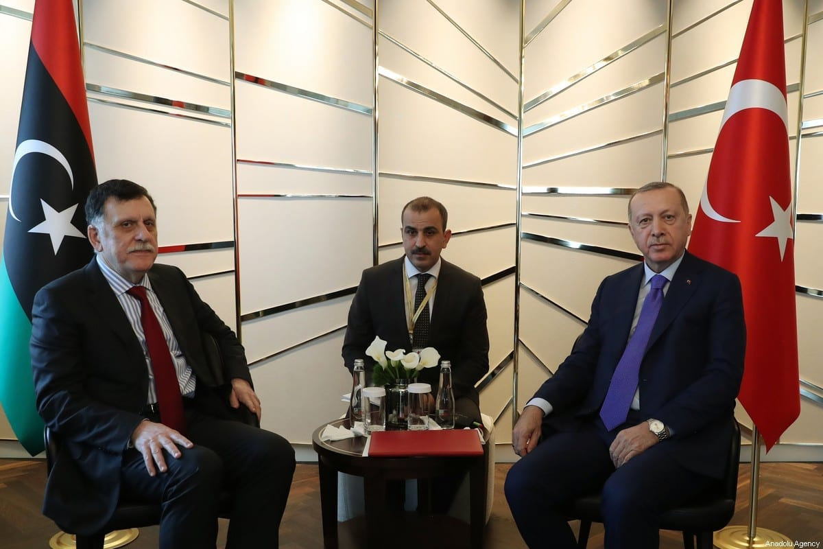 Turkish President Recep Tayyip Erdogan (R) meets with Chairman of the Presidential Council of Libya's Government of National Accord (GNA) Fayez al-Sarraj (L) within the Berlin Conference on Libyan peace in Berlin, Germany on 19 January 2020. [Turkish Presidency / Murat Cetinmuhurdar / Handout - Anadolu Agency]