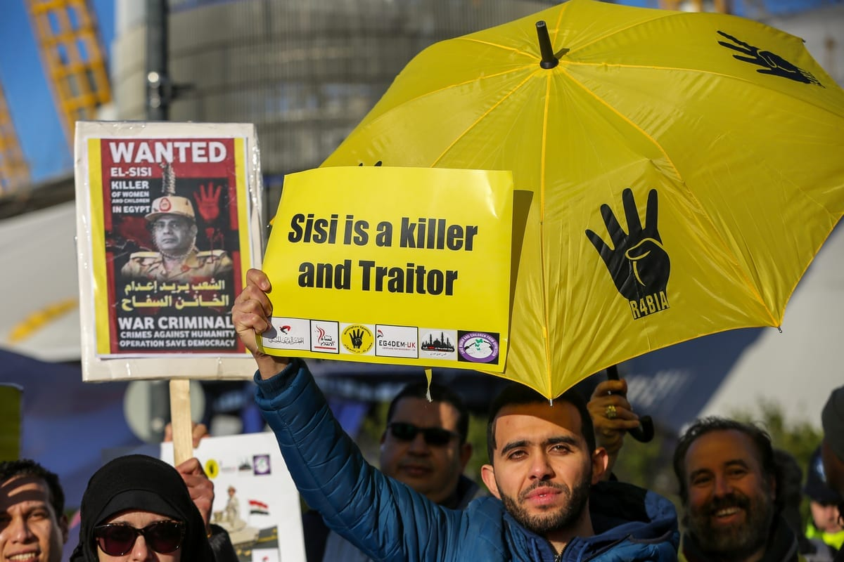 Protesters from the Egyptian Revolutionary Council and UK anti-Coup organisations demonstrate outside InterContinental Hotel against President of Egypt, Abdel Fattah Al-Sisi who is in London on 20 January 2020 [Dinendra Haria/Anadolu Agency]