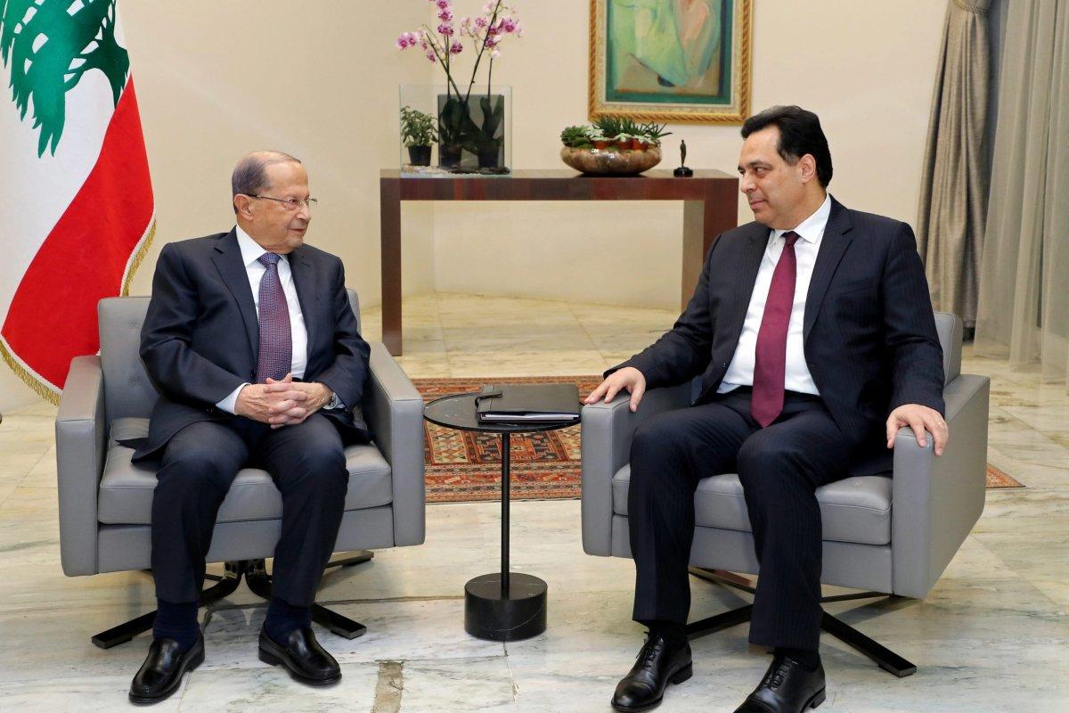 Lebanese President Michel Aoun (L) receives Prime Minister-designate Hassan Diab (R) at Baabda Palace in Beirut, Lebanon on 21 January, 2020 [Lebanese Presidency Handout/Anadolu Agency]