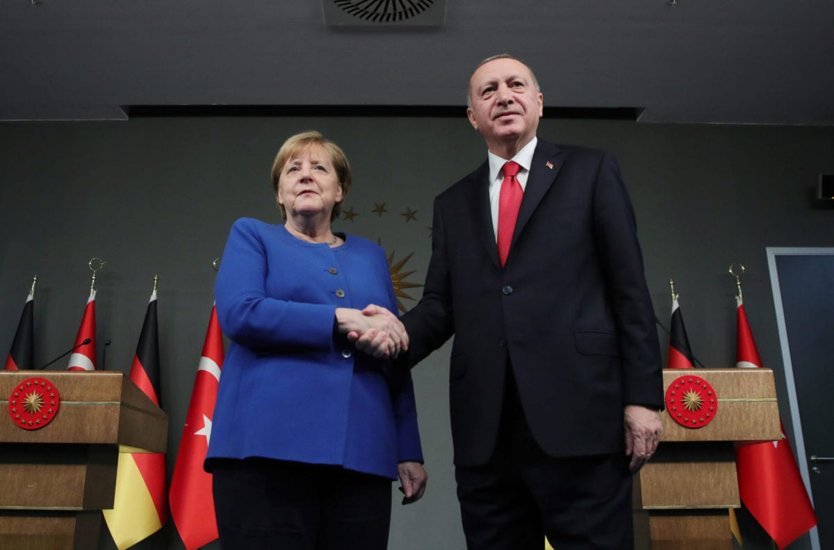 President of Turkey, Recep Tayyip Erdogan (R) and German Chancellor Angela Merkel (L) shake hands at the end of a joint press conference in Istanbul, Turkey on 24 January 2020 [Murat Kula/Anadolu Agency]