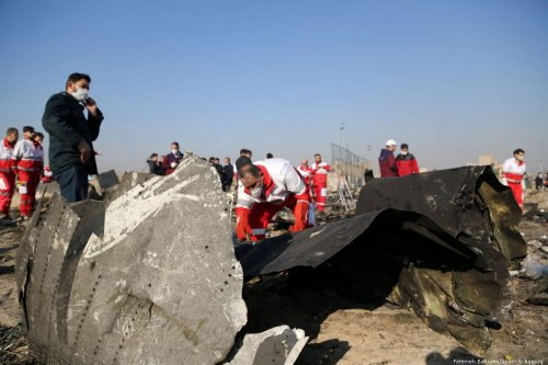 Officials inspect pieces of of a Boeing 737 plane belonging to a Ukrainian International Airlines after it crashed in Iran on 10 January 2020 [Fatemeh Bahrami/Anadolu Agency]