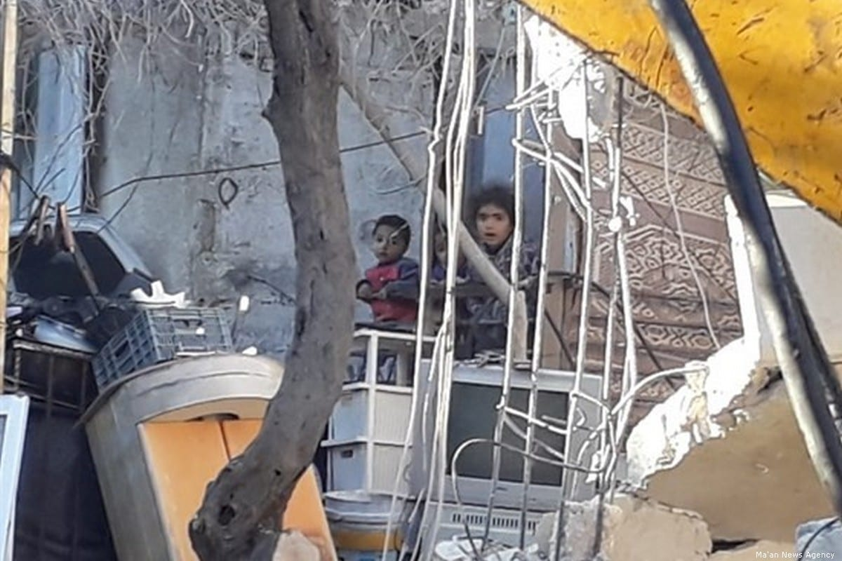 Children are seen among the rubble of the their house after Israeli forces ordered it to be demolished in Jerusalem on 6 January 2020 [Ma'an News Agency]
