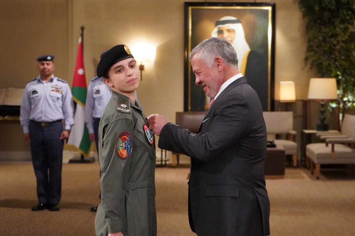 Jordan's Princess Salma Bint Abdullah (L) receives her wings after being the first Jordanian woman to complete preliminary pilot training on fixed wing aircraft in Jordan on 9 January 2020 [Twitter]