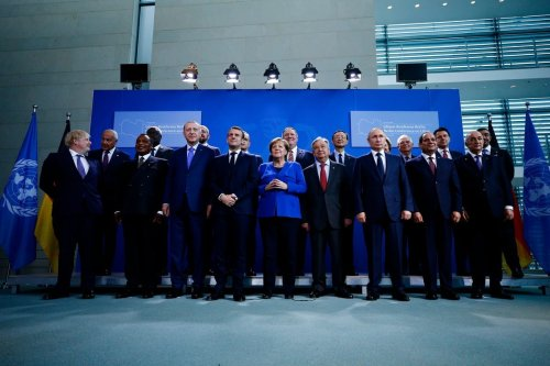 World leaders pose for a photo during the Berlin Conference on Libyan peace in Berlin, Germany on 20 January 2020 [Abdulhamid Hosbas/Anadolu Agency]