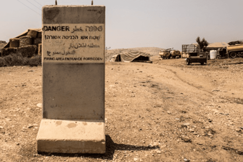 A concrete marker placed by Israeli forces demarcating the beginning of the military zone near Tubas in the Jordan Valley, northern West Bank [DCIP/Cody O'Rourke]